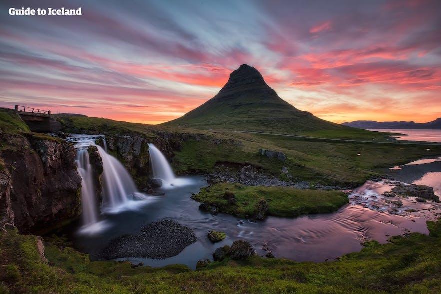 The distinctive shape of the mountain Kirkjufell and its resident waterfall Kirkjufellsfoss are what draws nature photographers to the Snæfellnes Peninsula.