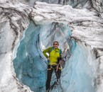 On a glacier hiking tour on Sólheimajökull glacier, you'll see spectacular sculptures of blue ice, white snow and black ash