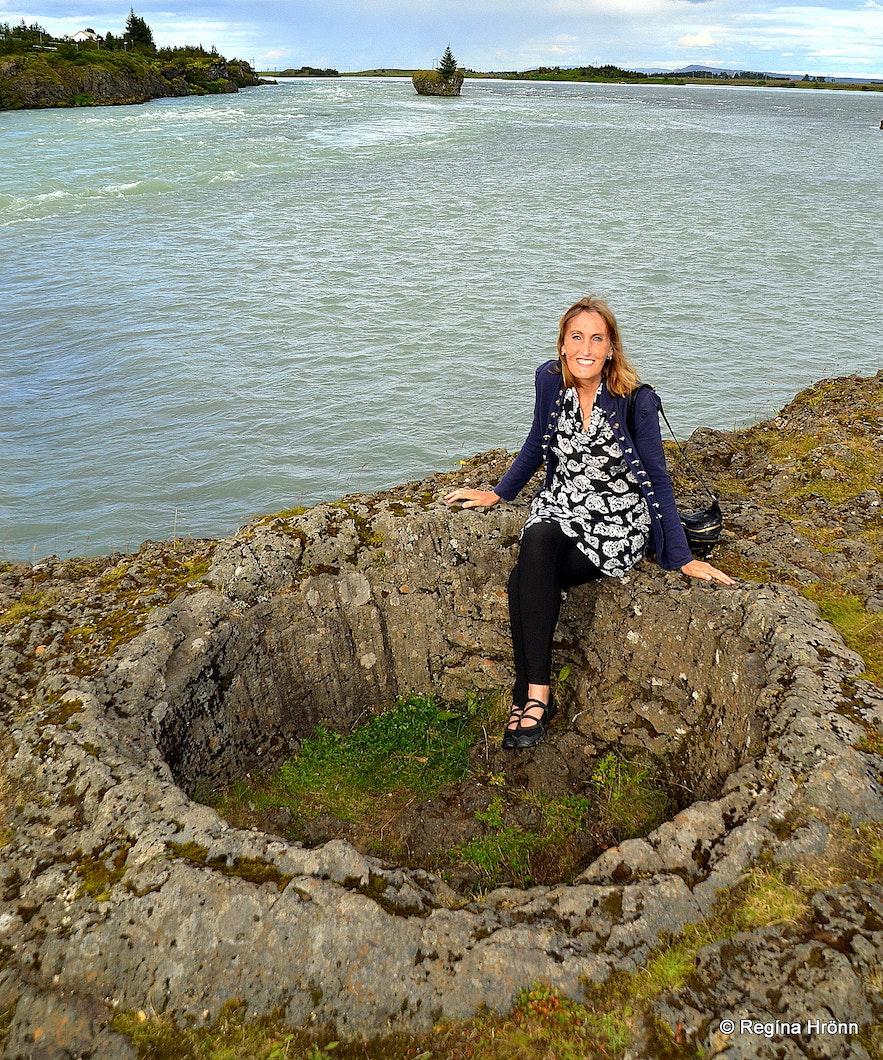 Regína sitting in a lava pot by Ölfusá South-Iceland