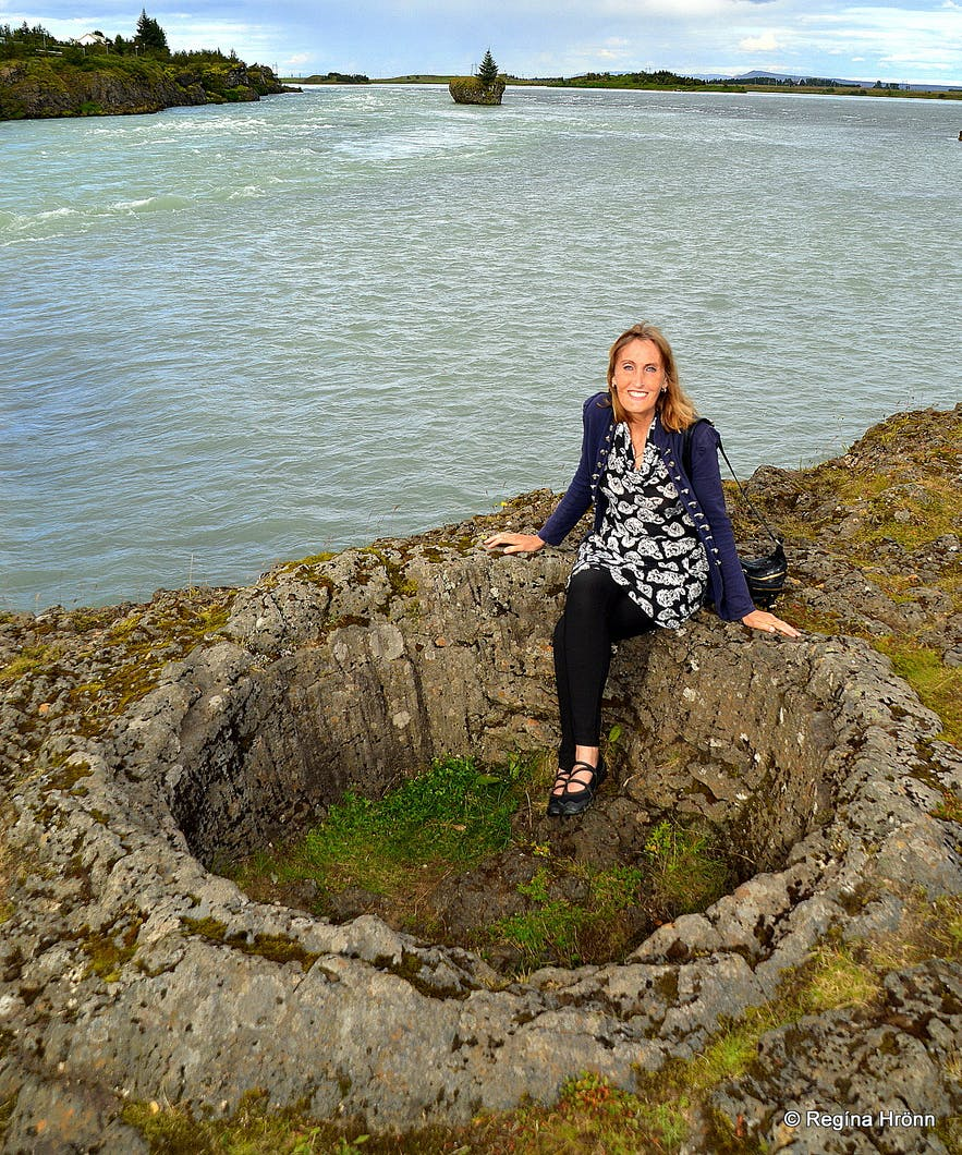 Regína sitting in a lava pot by Ölfusá South-Iceland