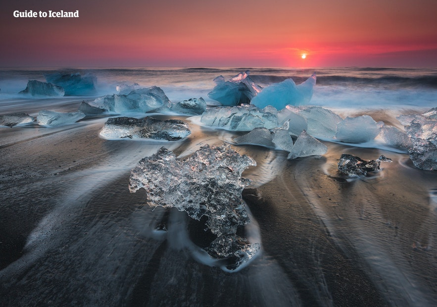 Glistening icebergs melting in the Diamond Beach.