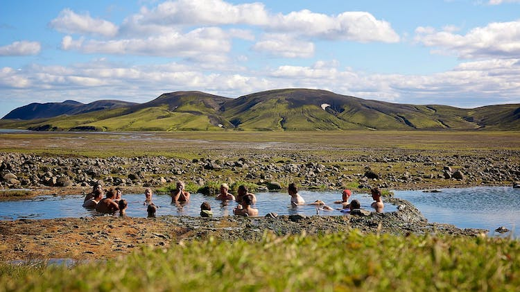 Strútslaug is a beloved natural hot pool next to a glacial river in the Highlands of Iceland.