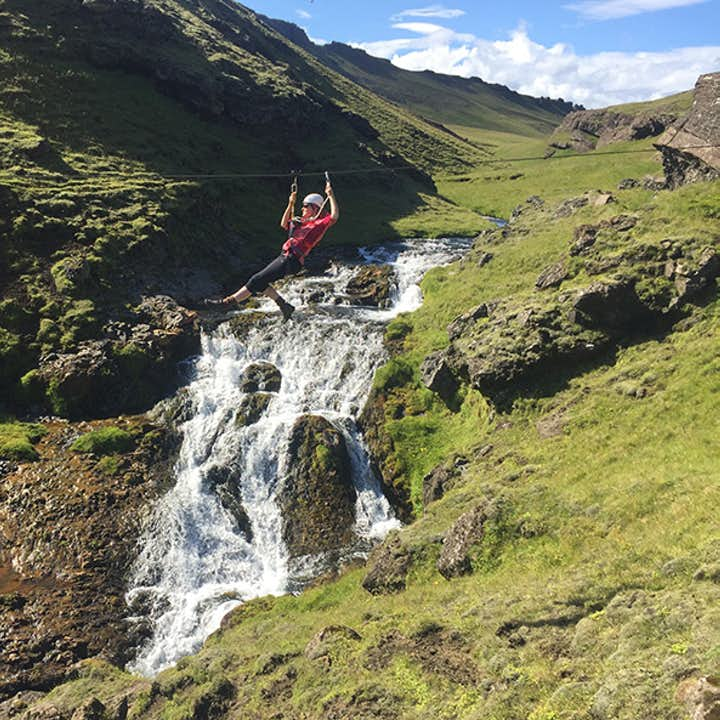 From the village of Vík on the South Coast, you can take a zipline adventure tour where you fly past a stunning waterfall.