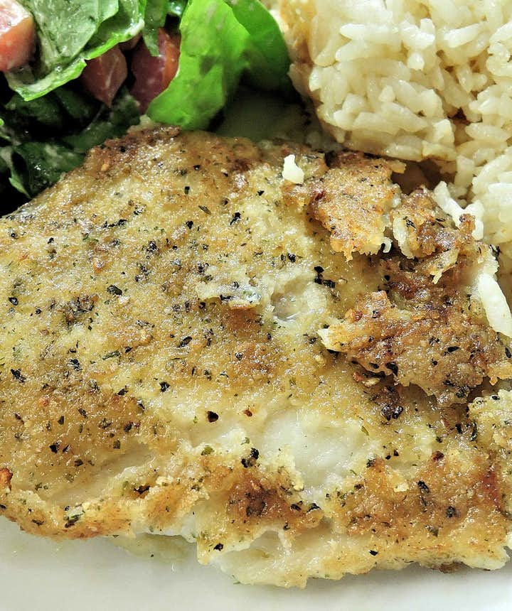 Baked fish served with rice.