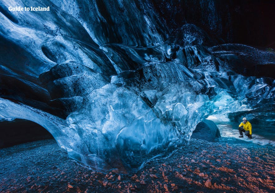 A dazzling blue ice cave inside of a glacier in Iceland.