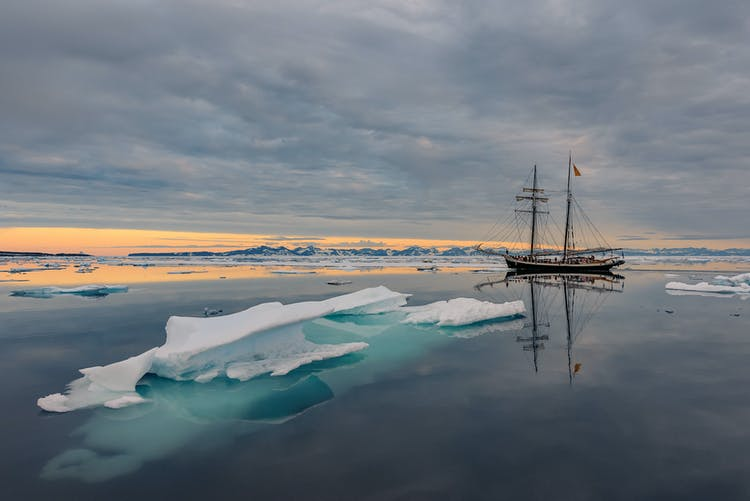 The Donna Wood vessel silently trailing past icebergs off the coast of Greenland.