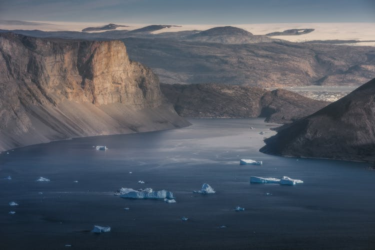 The steep and majestic coastal cliffs of Milne Land in Greenland.
