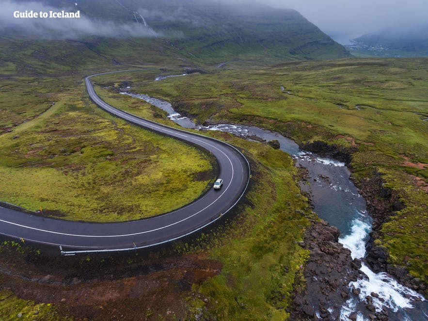 A lone car zigzagging its way through Seyðisfjörður Fjord in East Iceland.