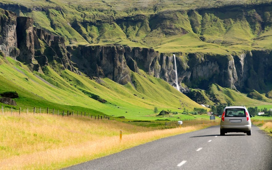 Driving the Ring Road of Iceland means fantastical sceneries all around, such as cascading waterfalls and fields of green.