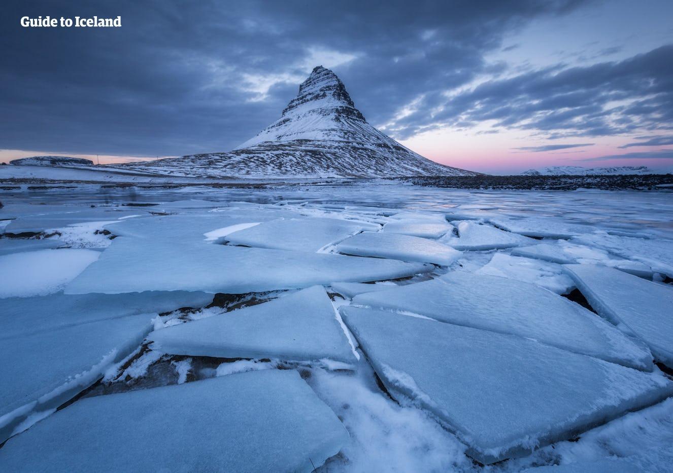 Frozen landscapes of the Snæfellsnes Peninsula surround Mount Kirkjufell.