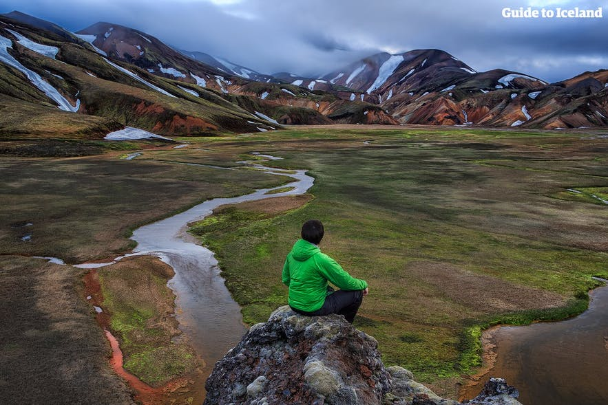 A hiker marvels over the beauty of Landmannalaugar.