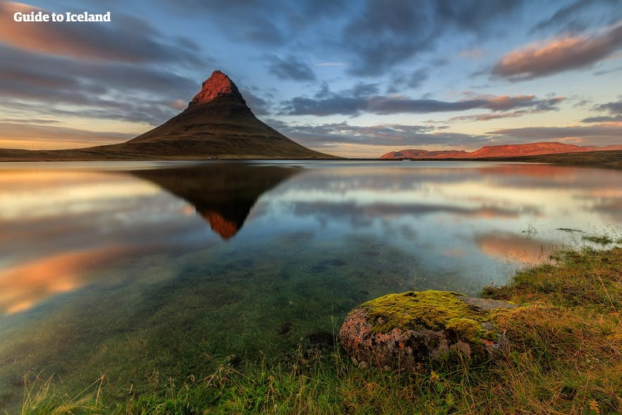 The mountain Kirkjufell on the Snæfellsnes Peninsula during a particularly scenic summer's day.