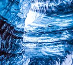 You'll see the electric blue ice mixed with black ash created in past volcanic eruptions on an ice cave tour on the South Coast.