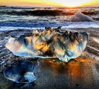 See sparkling icebergs that have washed up on the shore of the Diamond Beach.
