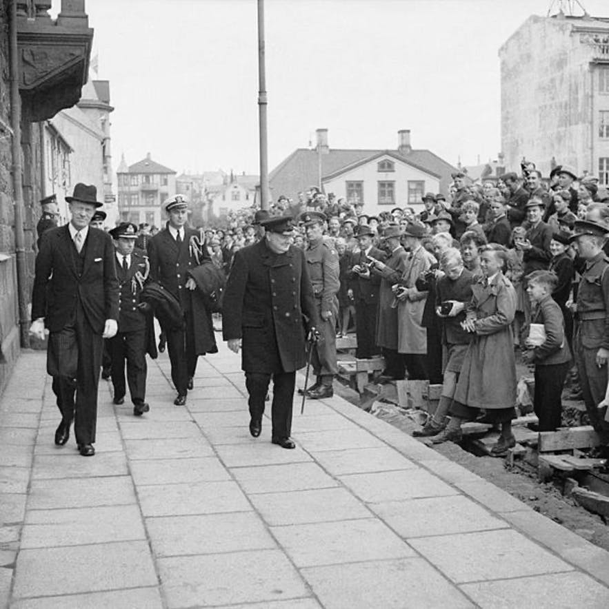British Prime Minister, Winston Churchill, walking down a street in Reykjavik.