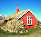 A traditional Icelandic turf house come to life with a fresh coat of red paint.