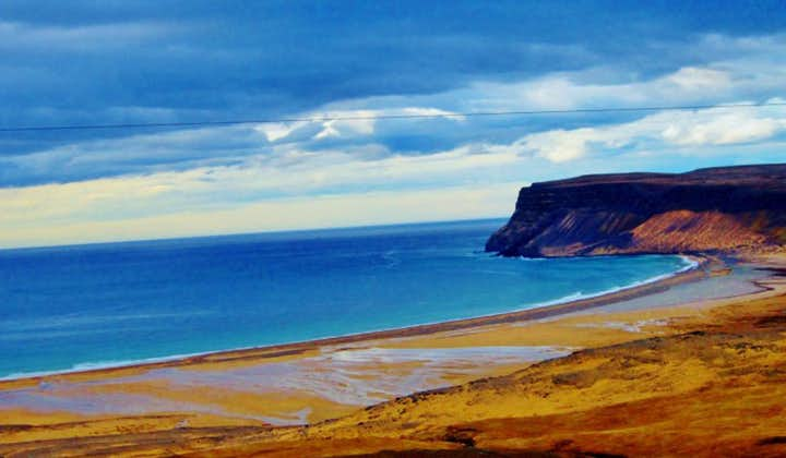 The blue of the ocean contrasts the golden beach Rauðasandur in the Southern Westfjords of Iceland.