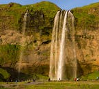 The unique Seljalandsfoss waterfall tumbles down over a cave.