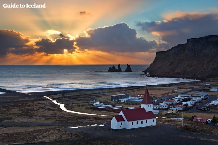 From Vík, you can look over to the Reynisfjara black sand beach, Reynisdrangar sea-stacks and the mountain Reynisfjall.