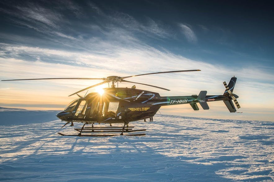 A helicopter that has landed on Langjökull, the second largest glacier in Iceland.