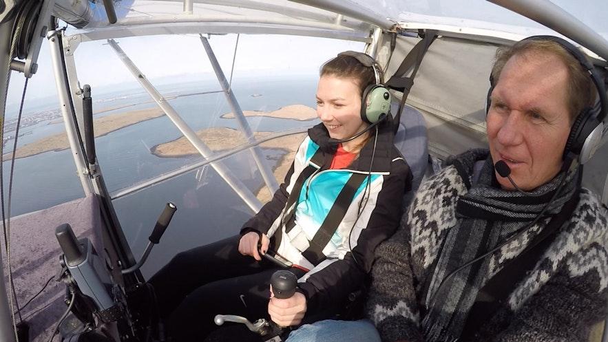 A passenger and a pilot in an UltraLight Buddy Aircraft.