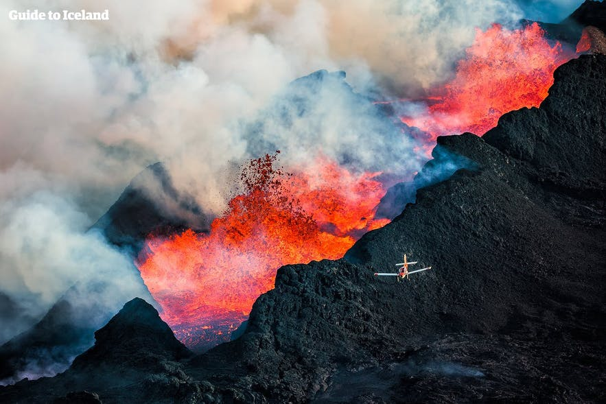 A light aircraft flying over eruptions at Holuhraun Lava fields.