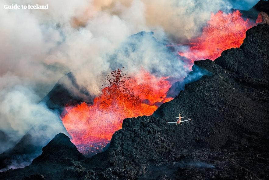 A light aircraft flying over eruptions at Holuhraun Lava fields.