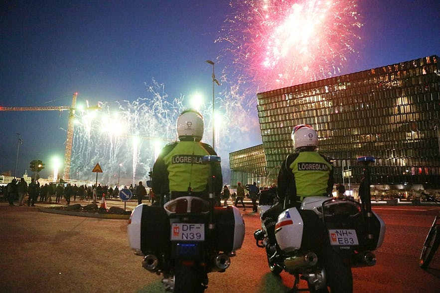 Police outside of Harpa Concert Hall during New Years celebrations.