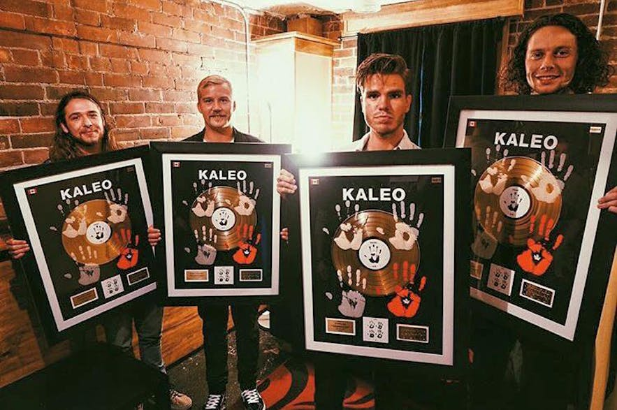 Kaleo showing off their first Gold record in Canada (2016).