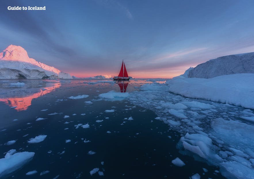 A yacht floats idly off Greenland's coasts.