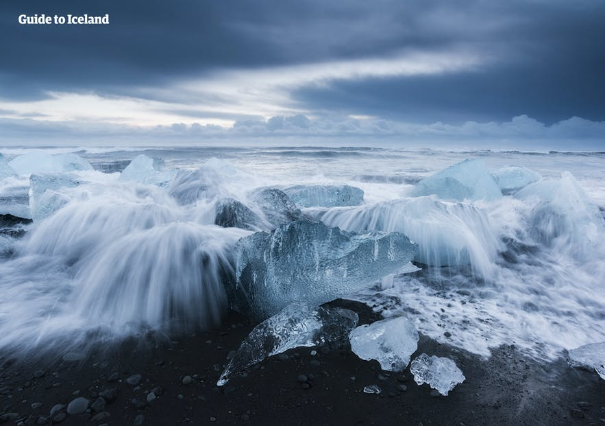 The Atlantic Ocean washes over icebergs on Diamond Beach, on the South Coast of Iceland.