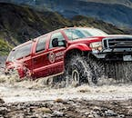 Super jeeps are specially built to cross rivers and handle Iceland's rough terrain.