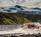 Crossing rivers is easy if you are driving a super jeep, a specially modified vehicle.