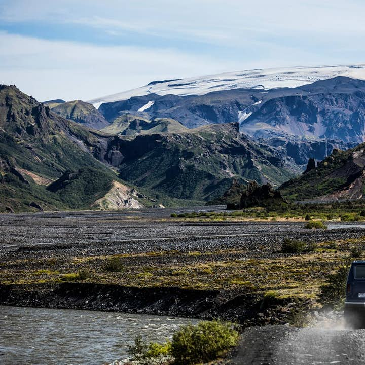 Green flora, black mountains and white glaciers of the Þórsmörk valley in the Icelandic Highlands.