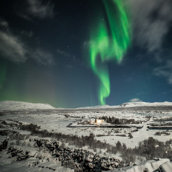 The beautiful Northern Lights moving like dancers in the sky above Þingvellir National Park.