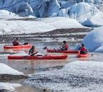 Add a kayaking tour on Sólheimajökull glacier lagoon to your South Coast trip.