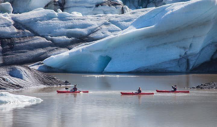 Paddle between icebergs on a kayaking tour on Sólheimajökull glacier lagoon.