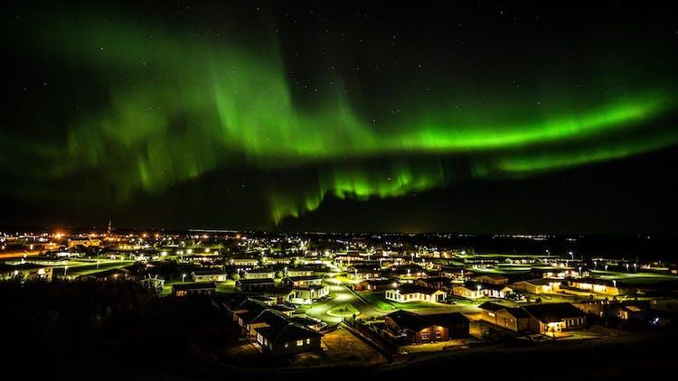 Northern Lights dancing above Hvolsvöllur in South Iceland.