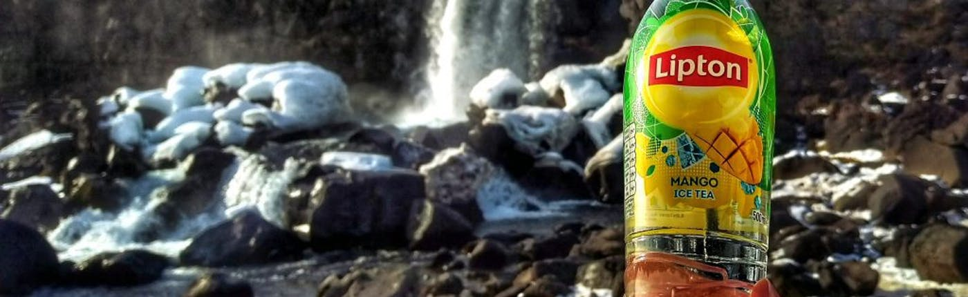 Drinking water from Oxararfoss waterfall in Iceland