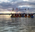 Kayakers at sunset, happy after a day of adventure, near Stokkseyri, south Iceland.