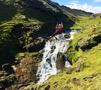 See beautiful waterfalls as you race by on a zipline.