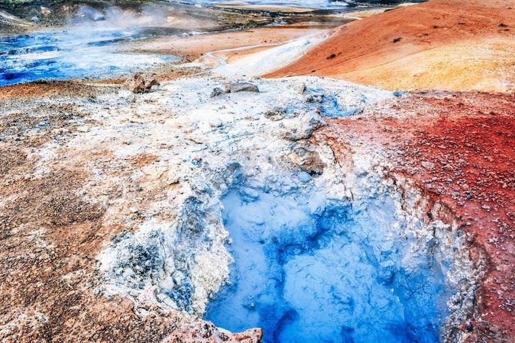 See bubbling mud pools and otherworldly landscapes at Námaskarð geothermal area near Lake Mývatn.