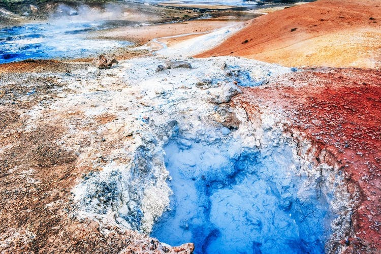 See bubbling mud pools and otherworldly landscapes at Námaskarð geothermal area near Lake Mývatn.
