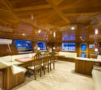 Relax inside the yacht and let the captain hunt for the Northern Lights.