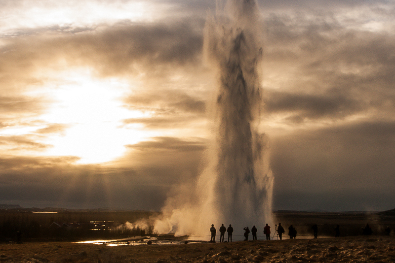 The mighty geyser Strokkur erupting high into the air.