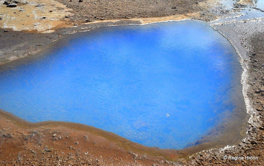 Blue pool of hot geothermal water in Geysir geothermal area in southwest Iceland.