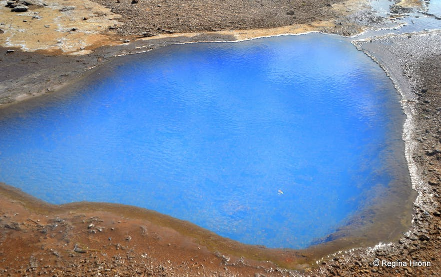 Blue pool of hot geothermal water in Geysir geothermal area in southwest Iceland.