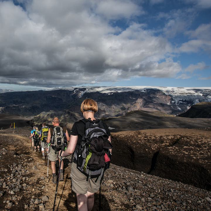 Hikers on a ridge path, where no grass grows. Icelandic highlands.