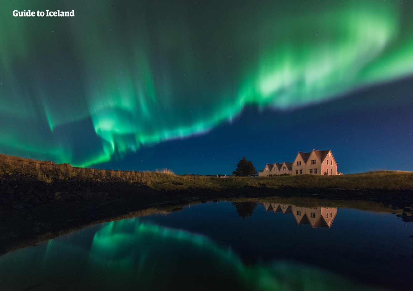 The beautiful Northern Lights dancing over a lonely house on the Reykjanes Peninsula.