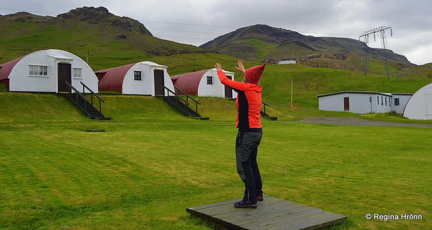 Our guide telling us stories by the barracks in Hvalfjörður